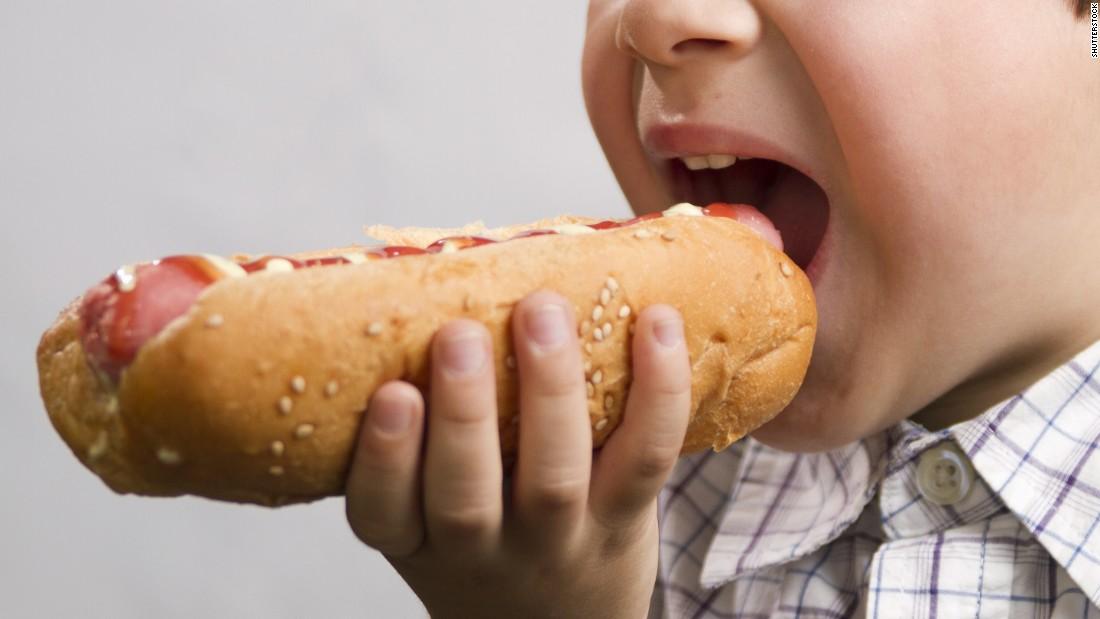 170905140330-boy-eating-hotdog-stock-super-tease